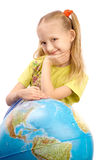 Little smiling girl  leaning  the globe. Royalty Free Stock Image