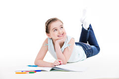 Little smiling girl lies with the book. Royalty Free Stock Photo