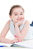 Little smiling girl lies with the book. Stock Photography