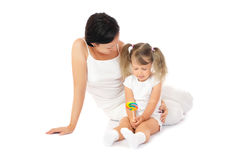 Little smiling girl with mother Stock Photos