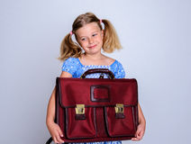 Little smiling girl with old satchel Royalty Free Stock Photo