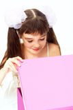 Little smiling girl opening christmas present. Space for text Royalty Free Stock Photo