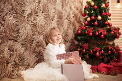 Little smiling girl opens a magic Christmas gift box Royalty Free Stock Photos