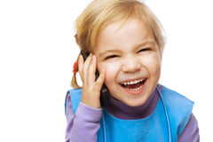 Little smiling girl with phone Stock Photos