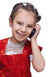 Little smiling girl with phone Royalty Free Stock Photography