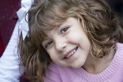 Little smiling girl in pink sweater Stock Photography
