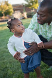 Little Smiling Girl Playing with Dad Stock Photo