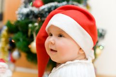 Little smiling girl in red Santa hat Royalty Free Stock Photos