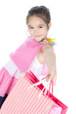 Little smiling girl with shopping bags over white Stock Images