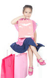 Little smiling girl with shopping bags over white Royalty Free Stock Photos
