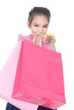 Little smiling girl with shopping bags over white Royalty Free Stock Image
