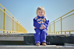 Little smiling girl on the stairs Royalty Free Stock Photography