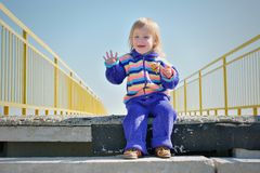 Little smiling girl on the stairs Royalty Free Stock Photo