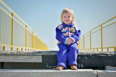 Little smiling girl on the stairs Stock Photography