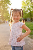 Little smiling girl in the sunlight. Royalty Free Stock Image