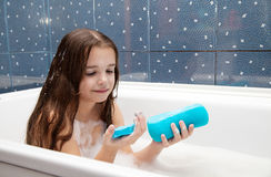 Little smiling girl taking a bath Stock Photography