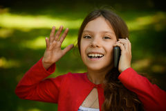 Little smiling girl talking on cell phone Royalty Free Stock Photo