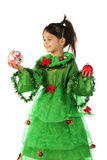 Little smiling girl with two Christmas decoration Royalty Free Stock Photo