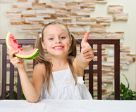 Little smiling girl with watermelon Stock Photography