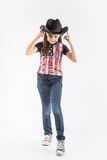 Little smiling girl wearing cowboy hat on  white background Stock Image