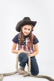 Little smiling girl wearing cowboy hat on  white background Royalty Free Stock Photos
