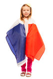 Little smiling girl wrapped in flag of France. Little smiling girl standing wrapped in flag of France, isolated on white Stock Photo