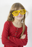 little smiling  girl in yellow sun glasses Royalty Free Stock Images