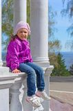 Little smiling gril on bench Royalty Free Stock Photography