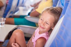 Little smiling happy girl in the aircraft Stock Photo