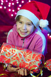 Little smiling happy girl with Christmas present  Stock Photos