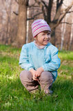 Little smiling little girl at forest Stock Photos