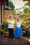 Little smiling siblings at birthday party Stock Photography