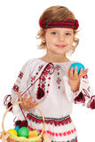 Little smiling Ukrainian girl with Easter basket Stock Image