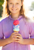 Little smilling girl holding ice cream cone Stock Photos