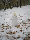 Little snowman at the beginning of the winter. Little snowman under the leaf at the beginning of the winter Royalty Free Stock Photos