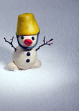 Little snowman made of plasticine standing on real snow Stock Images