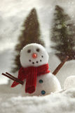 Little snowman with snow background royalty free stock images