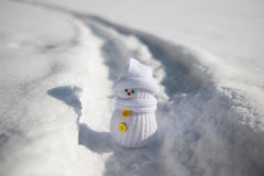 Little snowman stands on a path. In snow Stock Photos
