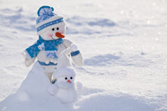Little snowmen with carrot nose. Royalty Free Stock Images