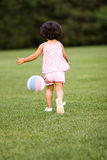 Little soccer player. Child playing soccer in the backyard Stock Photography