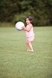 Little soccer player. Child playing soccer in the backyard Royalty Free Stock Images