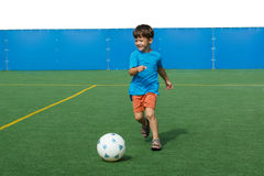 Little soccer player with ball Royalty Free Stock Images