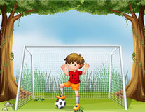 A little soccer player in his red uniform Stock Photo