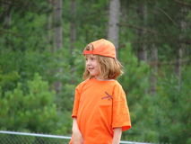 Little Softball Player. Little girl in her softball t-shirt and hat Stock Photography