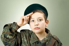 Little soldier. Young boy wearing soldier costume Stock Photos