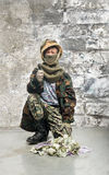 Little soldier with money Royalty Free Stock Photo