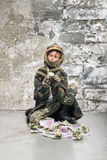 Little soldier with money Royalty Free Stock Photography