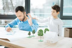 Little son distracting his father from work Royalty Free Stock Photos
