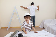 Little son drawing plans and father working Stock Photography