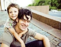 Little son with father in city hagging and smiling, casual look Stock Image
